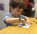 a boy draws