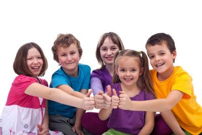 children giving thumbs up